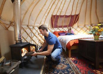 Couple Enjoying Glamping In Tent