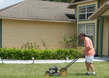 Gentleman Mowing Lawn
