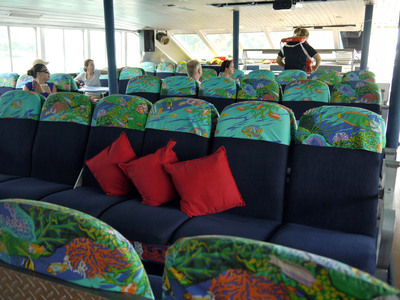 Spacious lounge style seating in our Air-Conditioned cabin.