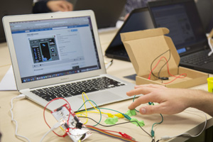 A makey makey connected to play-doh being used by a student