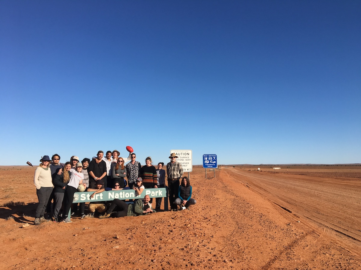 the group at Sturt National Park, blue sky above and red soil below