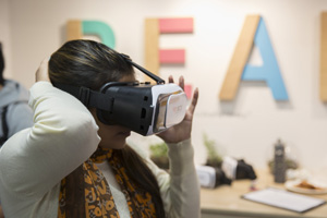 a female student with a VR headset on
