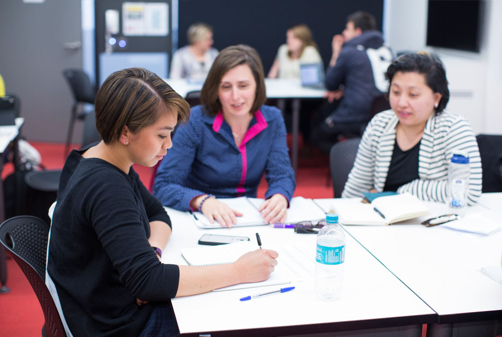 Postgraduate students learning in collaborative teaching space