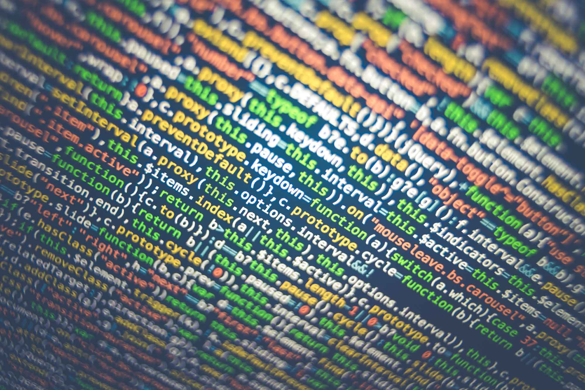 Closeup of a screen full of colourful code