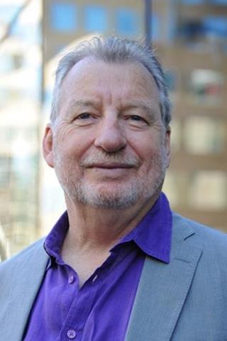 man with grey hair looking at camera, Jock Collins