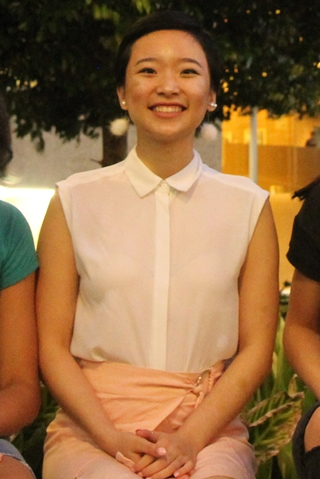person in white blouse, smiling at camera, Alice Zhang
