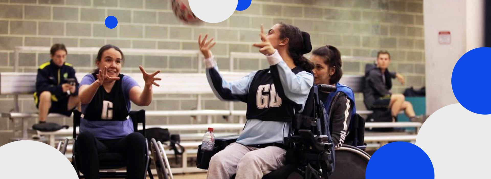 A group of people in wheelchairs playing Wheelchair Netball