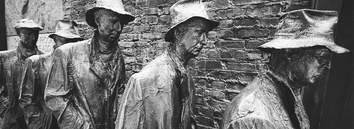 Stone statues of men during the great depression