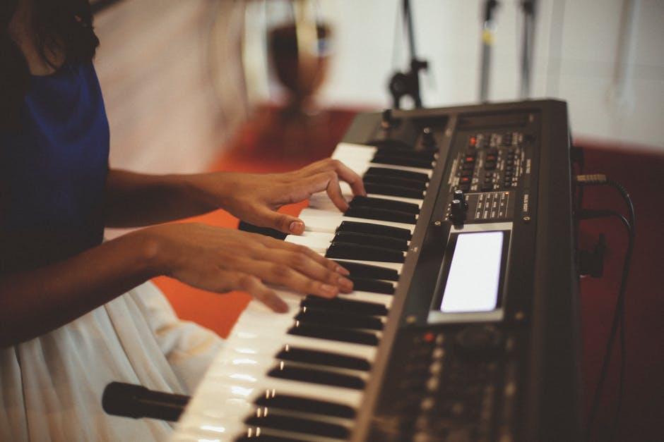 hands playing keyboard piano