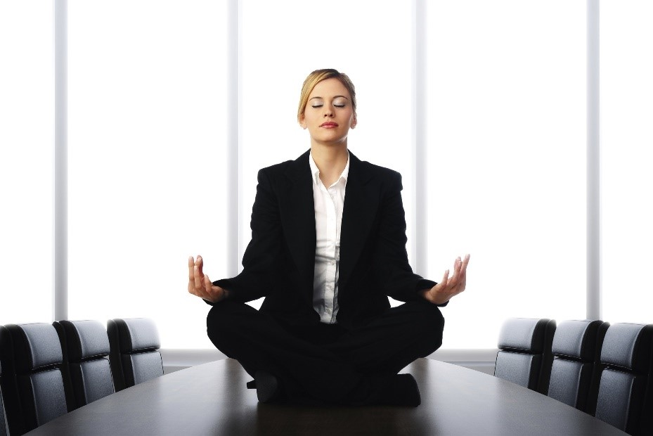 Corporate office woman meditating