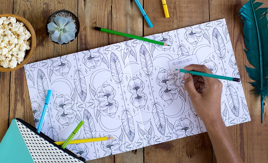overhead view of a colouring book
