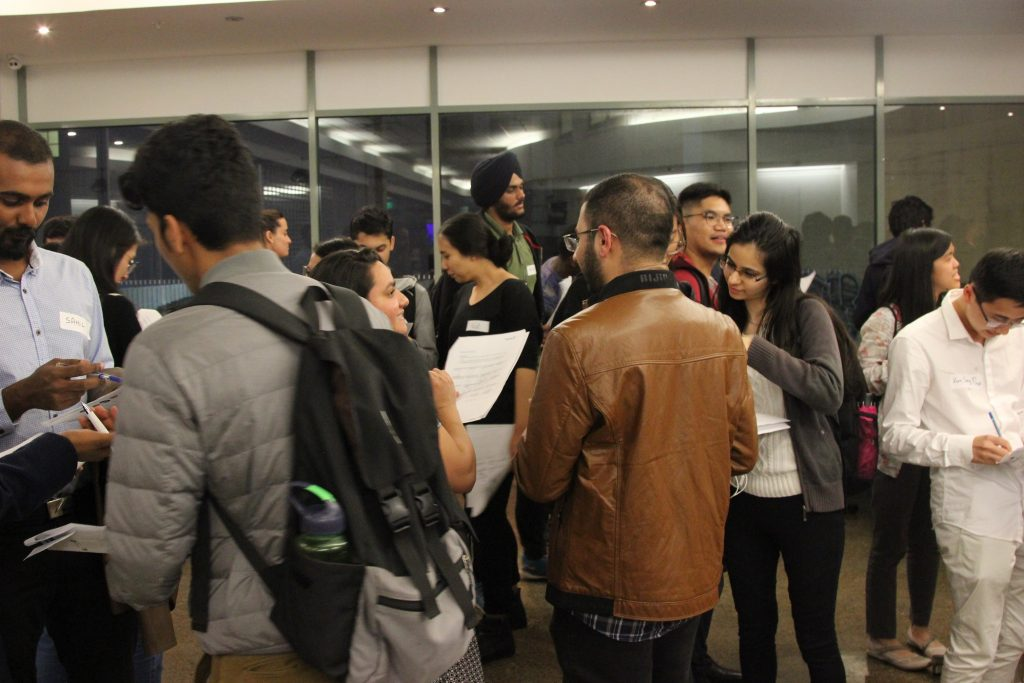 group of people at networking event, casual clothing