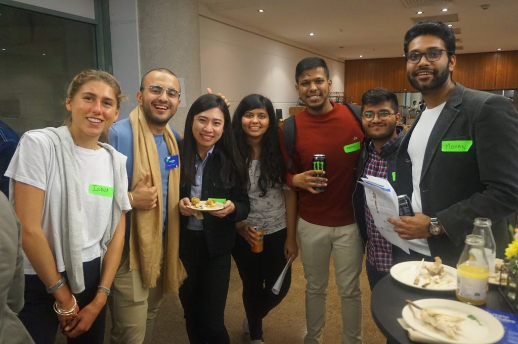 7 students smiling at the camera at networking event