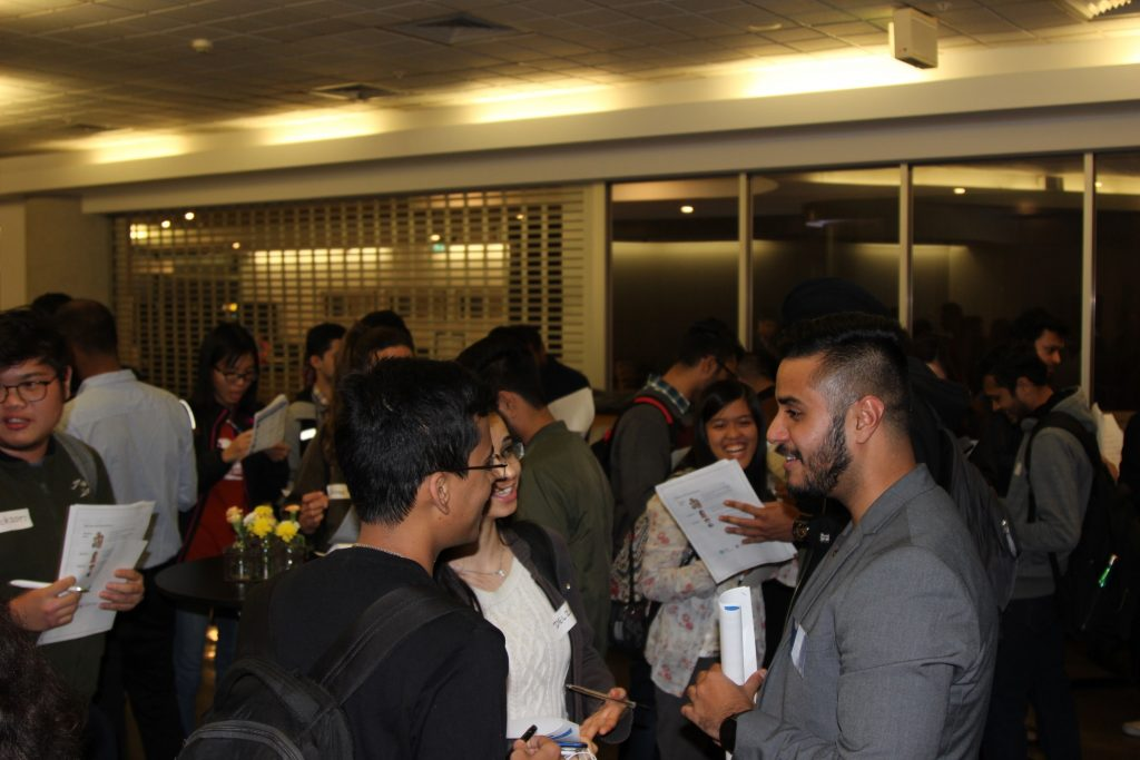 students chatting at networking event