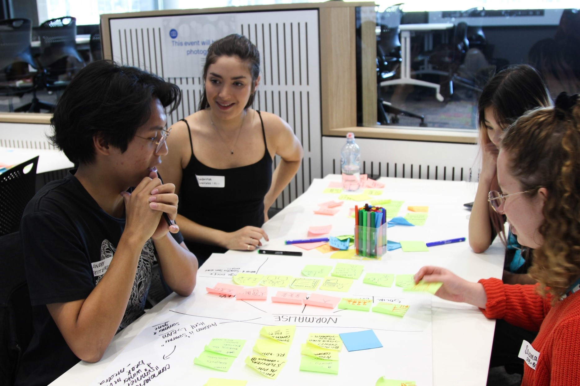 Students around a table in discussion