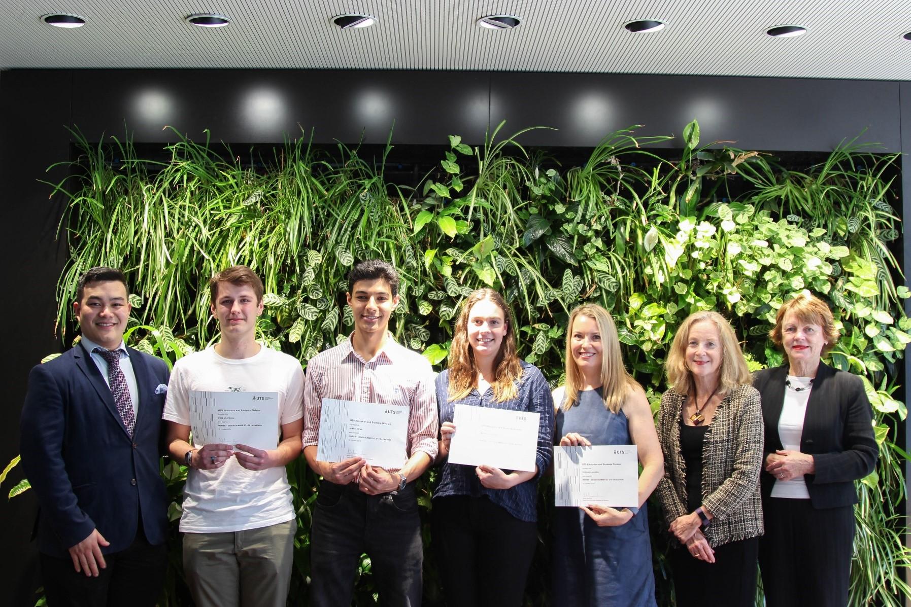 Winning team holding certificates