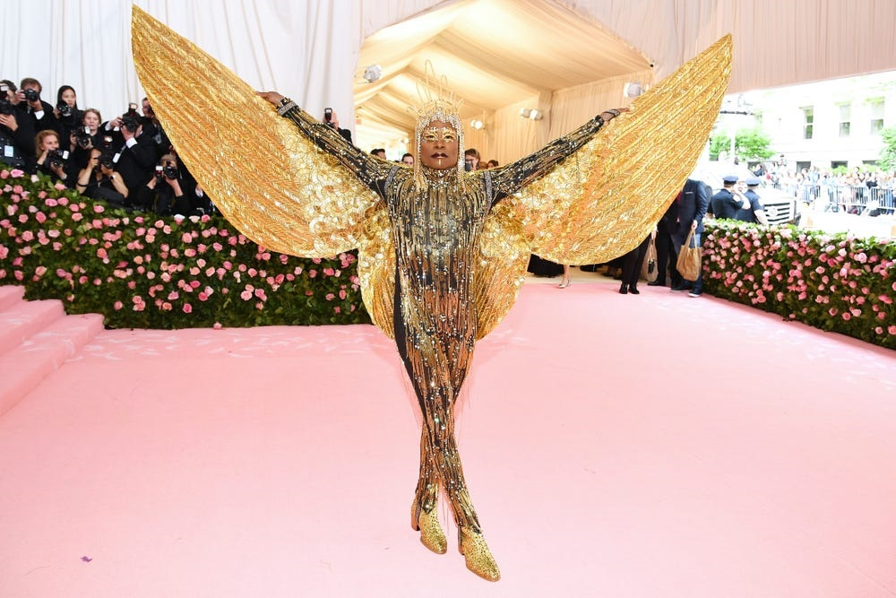 Billy Porter at the 2019 Met Gala in a gold catsuit with golden wings spread