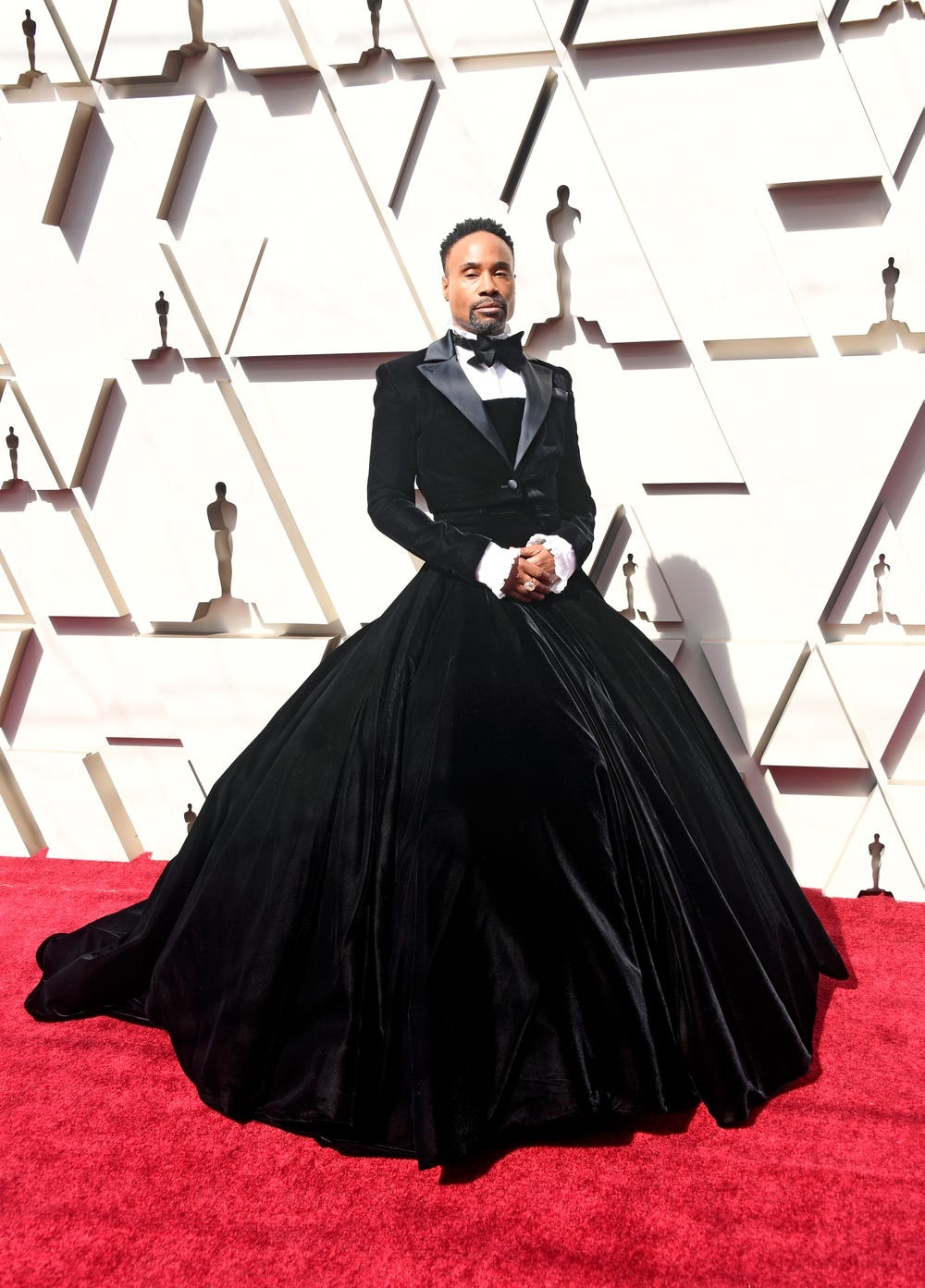 Billy Porter at the 2019 Oscars in a black ball gown with tuxedo on top and full skirt