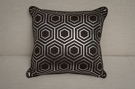 Square Charcoal and Geometric Print Cushions. Image: Cromwell
