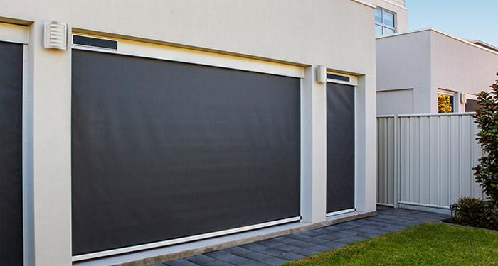 motorised-cafe-blinds-adelaide-dark-mesh-white-walls