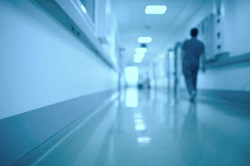 47049917 - blurred medical background. moving human figure in the hospital corridor