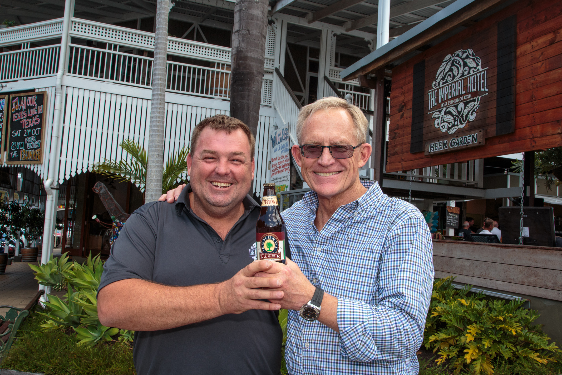 imperial-hotel-manager-brendan-fenlon-and-chuck-hahn-with-a-bottle-of-th