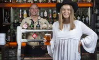 Eliza Gray, from Texas in western Queensland has a beer with Mick McKeown from the Great Northern brewing Co, at the Criterion in Brisbane, Monday, August 13 2018. Great Northern Brewing company is donating 1000 kegs to 500 pubs for a drought relief fundraising event to be held across three states on August 26, with all proceeds going to helping farmers. (Photo by Jono Searle Photography)