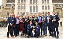 Trophy winners celebrate their win outside London's Guildhall
