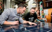 Sydney - October 23, 2015: Jake Steele (l) of Solargain and Oscar McMahon of Young Henry's with a solar panel inside the Young Henry's brewery. Solar panels are to be installed on the brewery roof as part of a community solar project (photo by Jamie Williams/City of Sydney)