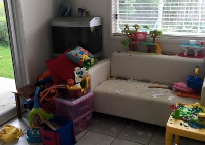"""3 of 5 """"Before"""" photo of the other side of this kids playroom."""