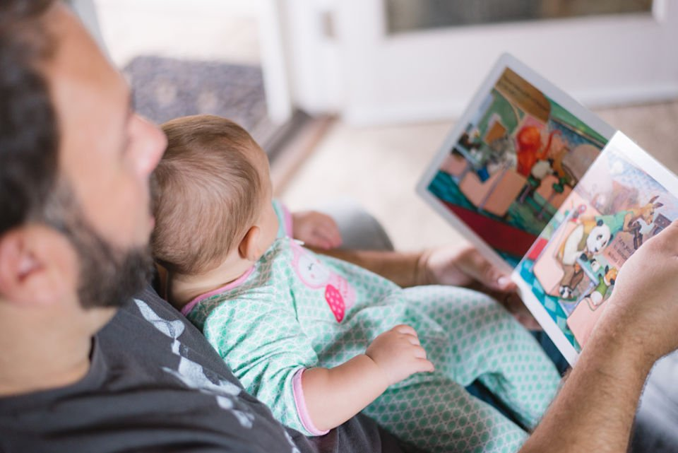 dad reading baby