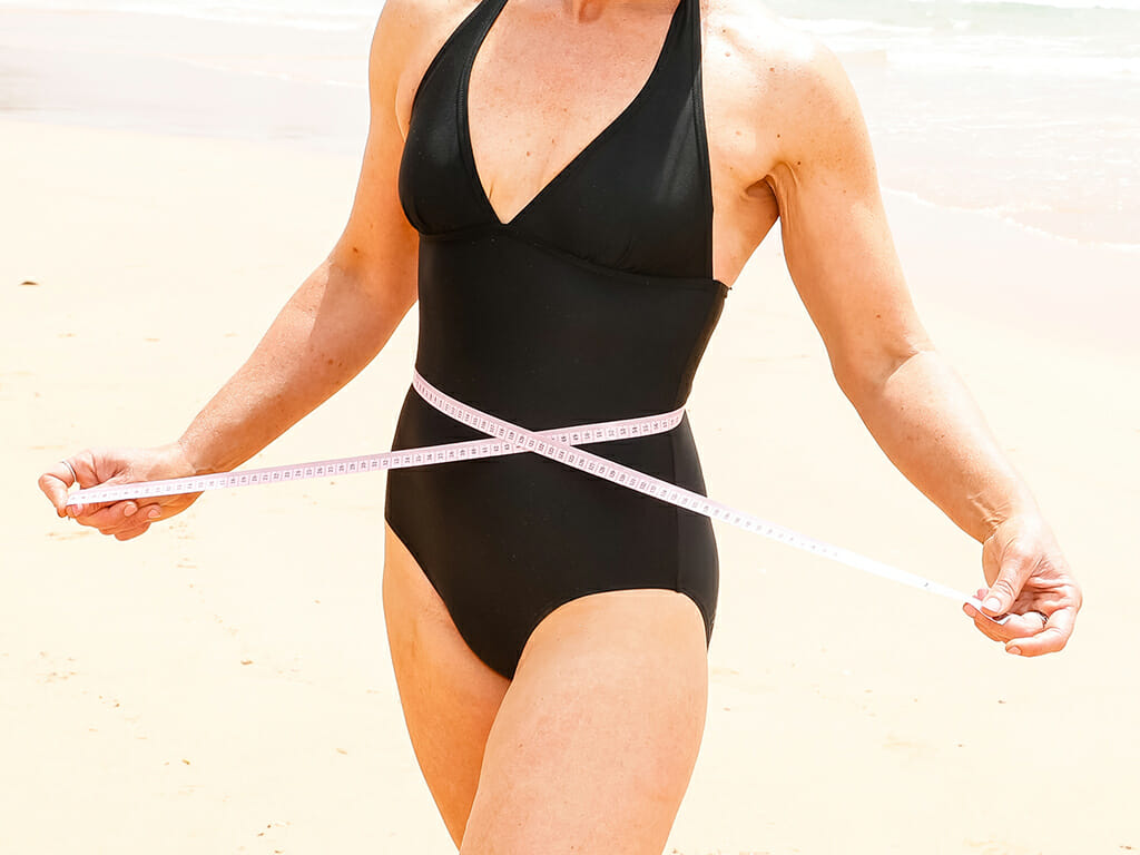 Jenni-with-measuring-tape-beach-swimwear-fear-weight-loss