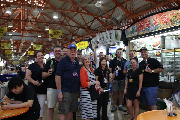 Checking out the food stalls and sampling a local brew in Singapore