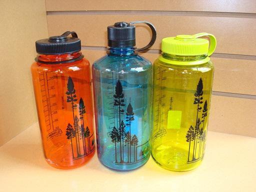Reusable plastic water bottles.
