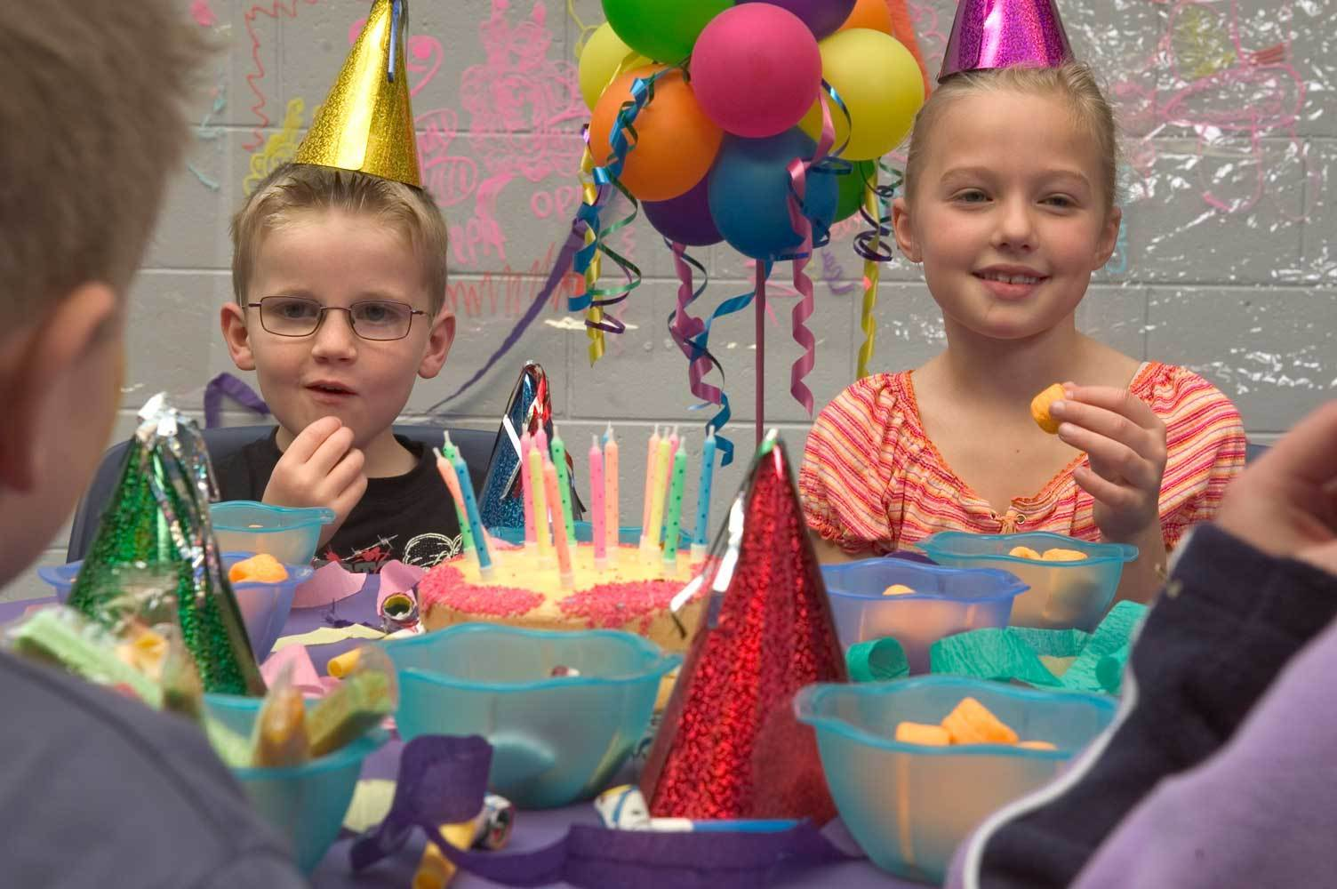 Kids with party hats on at birthday party