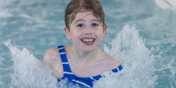 Girl splashing in water