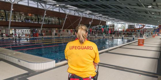 Lifeguard watching over 50 metre pool