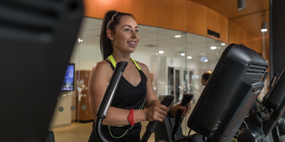 Woman on exercise equipment