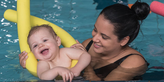 Mum and little boy swimming together