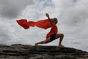 Simon Borg-Olivier. Virabhadrasana in a Clovelly Cliff Storm, by Stuart Fell