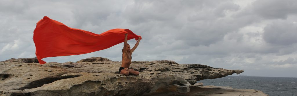 Simon Borg-Olivier. Padmasana in a Clovelly Cliff Storm, by Stuart Fell