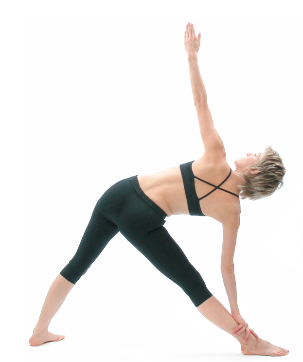 Figure 3: Utthita trikonasana (extended triangle pose): In postures like utthita trikonasana (extended triangle pose) keep the centre line of the thigh bone (femur) in line with the centre line of the shin bone (tibia), i.e. turn the thigh out as much as the foot and shin bone are turned out.