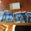 Xbox 360 map and some games covers and manuals Skyrim, Rugby World Cup Halo