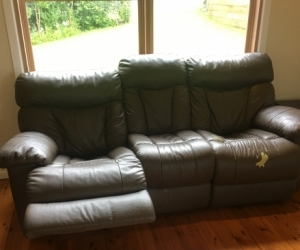 Comfy brown leather recliner couch.