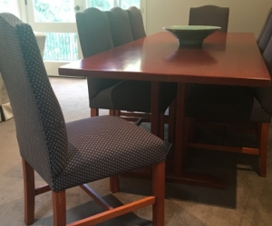 solid timber dining table and 8 timber upholstered chairs