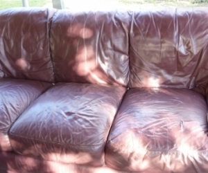 Free burgundy leather 3 seater and 2 seater couches