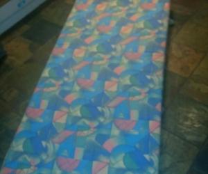 Single bed sized foam mattress with geometric design