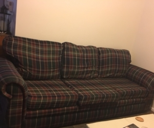 Large long  couch, checked fabric, old but sturdy.