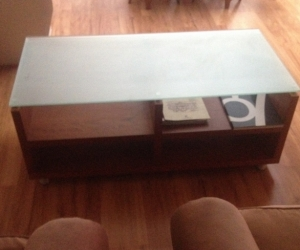 Frosted glass top, timber coffee table.