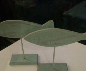 2 x wooden fish sculptures